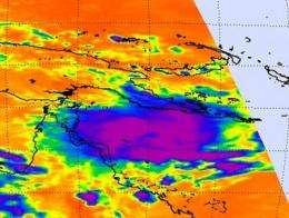 NASA's Aqua Satellite sees tropical potential in system 94P