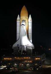 Space shuttle Discovery fixed, back on launch pad (AP)