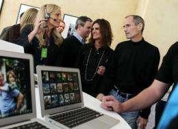 Apple CEO Steve Jobs (R)