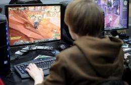 "A boy plays the computer game ""World of Warcraft"""