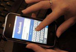 A cell phone user checking her facebook