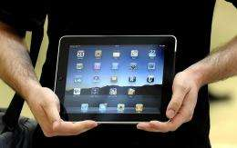 A customer poses with an iPad
