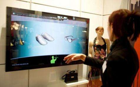 "A girl demonstrates the ""Interactive shopping window"""