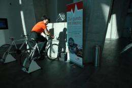 A guest pedals on a bike inside the eco-friendly Crowne Plaza Hotel in Copenhagen