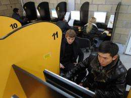 A Kyrgyz man surfs the internet at a cyber cafe in Bishkek, Kyrgyzstan