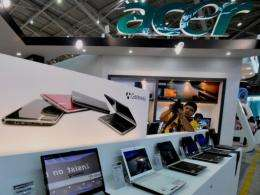 A man takes a picture at an Acer booth during the Computex fair in Taipei