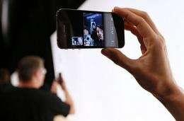An Apple employee demonstrates