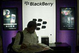 An Indian customer waits next to a BlackBerry display at a shop in New Delhi