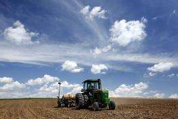 An Iowa farmer plants corn to be used for ethanol fuel in a field on a farm in 2007