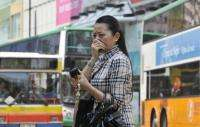 A resident covers her nose over pollution in Hong Kong