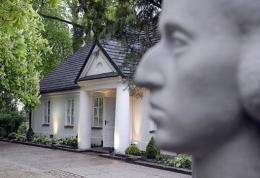 A sculpture of Polish composer Fryderyk Chopin is seen in front of a cottage in Zelazowa Wola