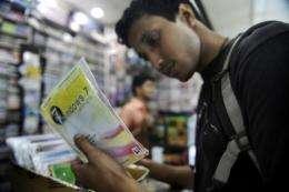 A shopper looks at counterfeit computer programmes in Dhaka, Banglasdesh