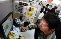 A Sohu employee inspects the popular Chinese portal's website in Beijing
