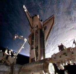 Astronauts embark on 1st spacewalk of mission (AP)