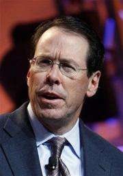 AT&T will take $1B non-cash charge for health care (AP)
