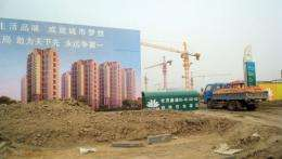 "A truck drives into the site of an ""eco-city"" which is now under construction near the port city of Tianjin"