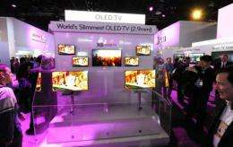 Attendees view LG Oled 2.9mm thin televisions at the 2011 International Consumer Electronics Show (CES) in Las Vegas
