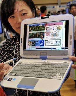 "A Uchida Yoko employee demonstrates the company's latest ""MC1"" PC tablet"