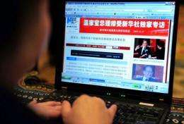 A woman reads a webpage in China