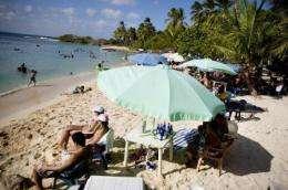Beach umbrellas do not block out all solar radiation