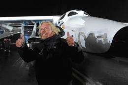 Billionaire entrepreneur Richard Branson gives the thumbs up in front Virgin Galactic's SpaceShipTwo