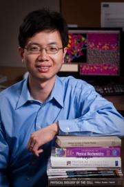Biochemist researching computer models of protein structure that help high school, college students