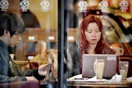 Chinese people surf the internet at a cafe in Shanghai