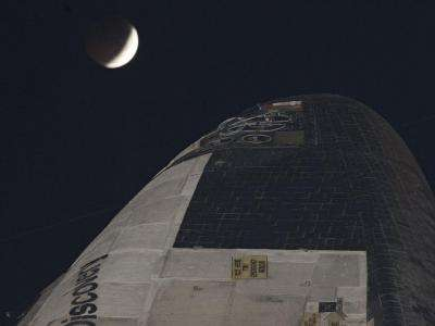 Discovery and the Lunar Eclipse