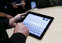 Event guests play with the new Apple iPad during an Apple Special Event in San Francisco in January.