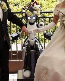 Eyes flashing, robot conducts wedding in Tokyo (AP)