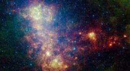Galaxy Exposes Its Dusty Inner Workings in New Spitzer Image