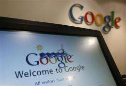 Google rides rising online ad sales to big 4Q (AP)