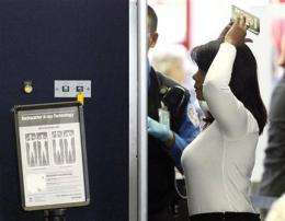 Gov't says full-body scanners at airports are safe (AP)