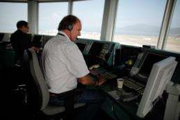 Inside the hot and stuffy glass bulb of the Hong Kong airport control tower, a dozen staff monitor flights