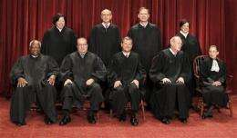 Justices weigh lawsuits over vaccine side effects (AP)