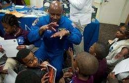 Leland Melvin speaking to elementary school students