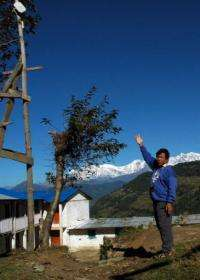 Mahabir Pun points to an antenna he set up in the village of Nagi in 2002