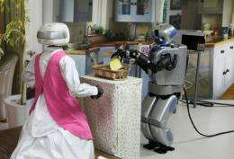 Mahru-Z (R), a robot developed by the Korea Institute of Science and Technology picks up a sandwich in Seoul