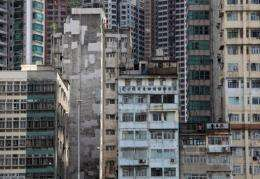 Modern apartments rise behind older buildings in the Sheung Wan district of Hong Kong