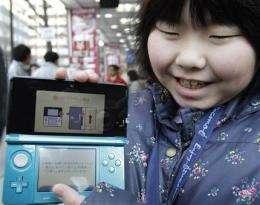 Nintendo 3-D handheld goes on sale in Japan (AP)