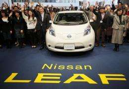 Nissan rolls out Leaf electric car in Japan (AP)