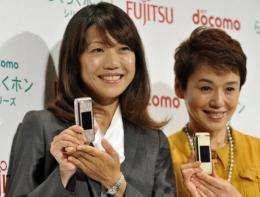 "Olympic marathon gold medalist Naoko Takahashi (left) and actress Shinobu Otake launch the new ""easy-easy"" model"