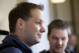 Pirate Bay founders Peter Sunde, left, and Frederik Neij attend court in Stockholm