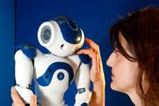 Robots that develop emotions in interaction with humans