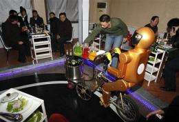 Robot waiters in China never lose patience (AP)