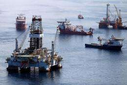 Ships work near the site of the BP Deepwater Horizon oil spill in August 2010