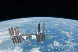 Space station cooling system suddenly shuts down (AP)