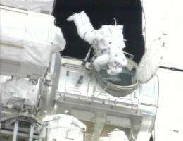Spacewalk hit by brief power outage, no danger (AP)