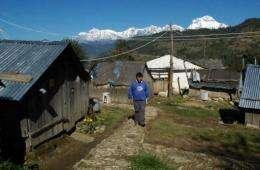 Teacher and IT specialist Mahabir Pun walks in the village of Nagi, some 200 kms west of Kathmandu