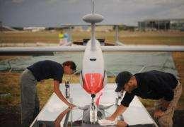 Technicians clean a QinetiQ Aerostar Tactical UAV unmanned drone